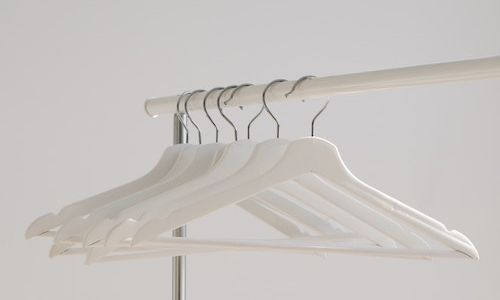 White hangars on a rail.