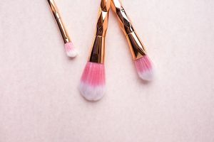 Make up brushes on a pink surfaces.