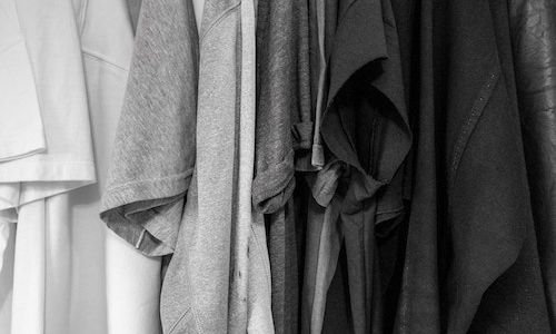 A greyscale photo of assorted clothes.