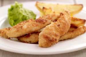 Chicken goujons on a plate.