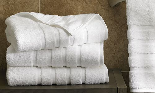 A pile of folded bathroom towels.